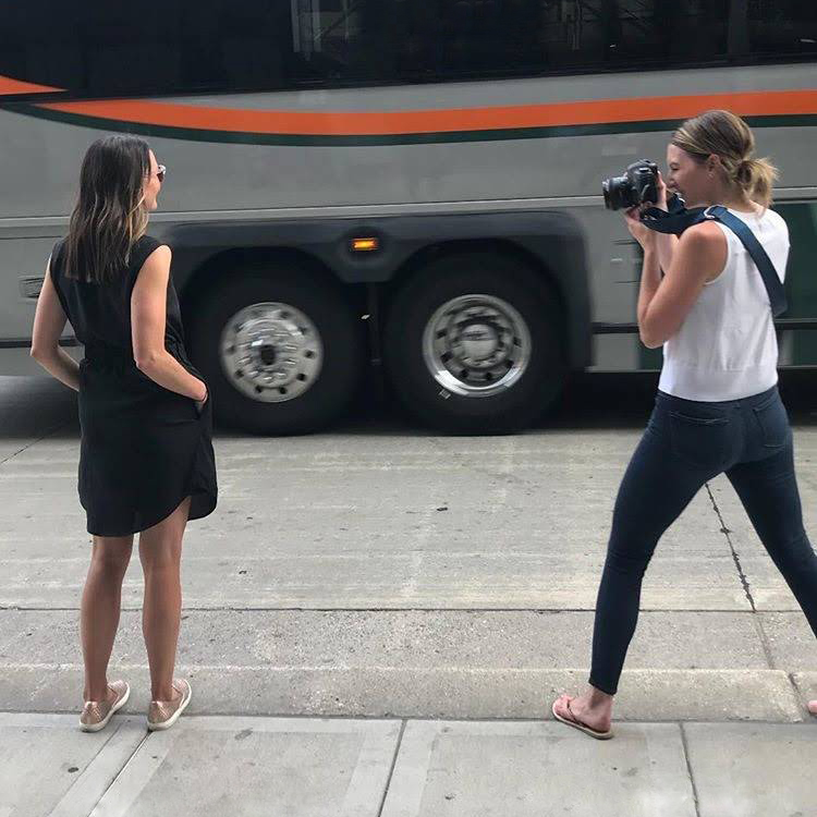 woman taking photo of model on street finn & gray