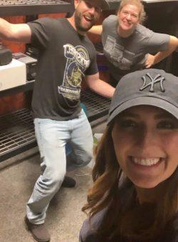 selfie of 3 people in storage room